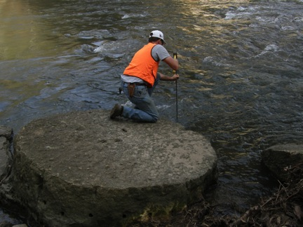 Dan Smith recording the measurements of the millstone