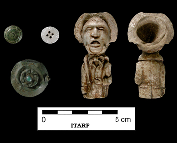 Buttons, pendant, and pipe bowl recovered from F26.