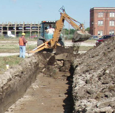 Site excavation with backhoe
